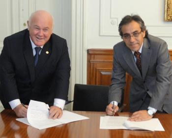 En primer turno, Hallú firmó un convenio con Guzmán.